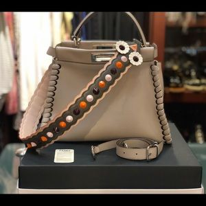 Fendi Scalloped studded leather shoulder strap.